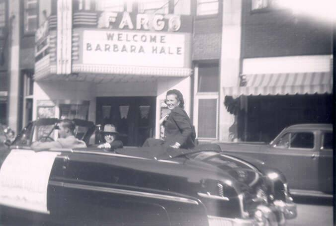 Barbara Hale in DeKalb for a homecoming parade in 1951 on Lincoln Hwy (Rt. 38) heading West in front of the old Fargo Theatre.